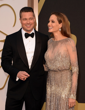 HOLLYWOOD, CA - MARCH 02:  Actors Brad Pitt (L) and Angelina Jolie attend the Oscars held at Hollywood & Highland Center on March 2, 2014 in Hollywood, California.  (Photo by Jason Merritt/Getty Images)