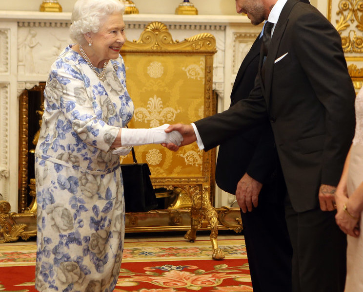 PHOTO: Queen Elizabeth and David Beckam. Photo Credits: Getty Images