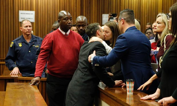 PHOTO: Oscar hugging his siter after the verdict. Photo Credit: theguardian.com